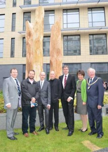 TRIBUTE - from left, Woking Borough Council chief executive Ray Morgan, Eagle Radio's Peter Gordon, artist Richard Heys, Rick Buckler, Barratt Homes managing director John Fitzgerald, mayoress Anne Murray and Woking mayor Michael Smith