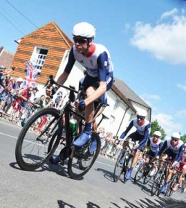 HEROES – fans in Ripley show their support as Team GB manoeuvre their way through the scenic village as Olympic fever grips the nation