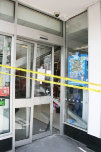 FORCED ENTRY – the buckled front door at the Co-op