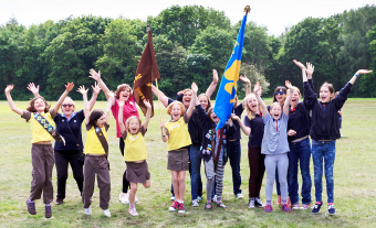 The Brownies & Guides lead the way at the start of the procession across the Lye