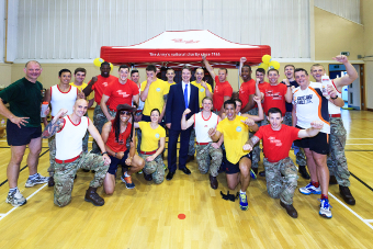 MUCK IN – Corp Scott Graham and Jonathan Lord MP with some the of Army participants at the Pirbright barracks gym
