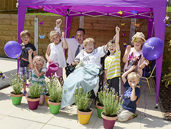 GRASS IS GREENER – resident Enid Peake with young helpers outside the winning Lakeview Care Home