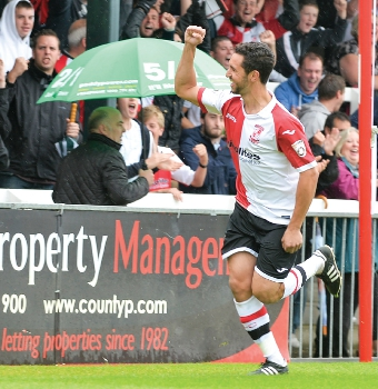 LET'S GET THIS PARTY STARTED – Giuseppe Sole celebrates after netting Woking's first in a six-goal demolition of strugglers Dover at Kingfield