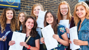 SMILES BETTER – the girls at SJB breath a sigh of relief after they picked up the results they were after last week