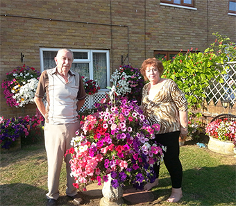 BLAZE OF COLOUR – couple Arthur and Carole Simpson in their beautiful front garden of petunias in Petersham Avenue in Byfleet