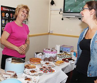 GOING DOWN A TREAT - Rachel takes care of the cakes at Woking Working Men's Club