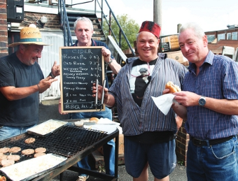 HUNGRY WORK - Knaphill Working Men's Club revellers tuck in to their grub