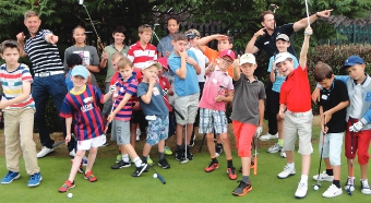 GRASS IS GREENER - a 'whole' lot of fun was had by the borough's aspiring golfers as they took on the courses at Hoebridge, ably assisted by the centre's resident coaches