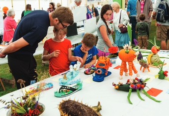 HEAD OF THE TABLE - Isabelle and Alex Depoix discuss the exhibits with dad Simong during the busy annual show