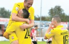 ON THE UP – Scott Rendell celebrates with team-mate Dean Morgan after the latter extended Woking's lead against struggling Altrincham