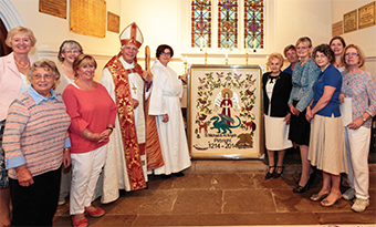 HISTORIC PRIDE – the bishop and vicar with the banner embroidery and most of the ladies who worked on it. It was inspired by Jadwiga Grimshaw (immediately to the right of the banner)