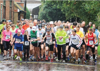 WET BUT UNDAUNTED – locals who appreciate the value of our hospices brave the elements in a previous year's run to ensure their security