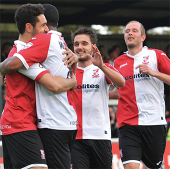 RED AND WHITE DELIGHT – team-mates embrace in-form goalscorer Giuseppe Sole
