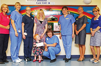 INTENSIVE CARE - (centre) mum Alison  and Hope with Dr Lawson and St Peter's neonatal staff
