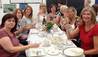 RAISE A GLASS – guests give a salute to the cause, with more than £3,000 eventually being collected