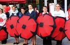 ALL FOR A GOOD CAUSE – poppy selling British Legion Brolly Ladies with The Three Belles in blue (centre)