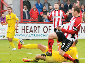 HE'S ON FIRE – striker Scott  Rendell fires Woking into a 1-0 lead against Altrincham (Picture by: David Holmes)