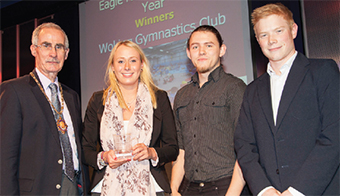 HIGH FLYERS – Mayor Branagan with members of Woking Gymnastics Club, awarded Club of the Year