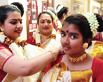 CAPTIVATED – teacher Mira Mani gives one of the dancers a helping hand