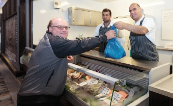 FISHING FOR A DEAL – Paul Cheetham buys some mackerel from Woking Quality Fishmonger