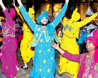 ALL BRIGHT ON THE NIGHT – Bhangra Punjabi performers entertain hundreds of visitors in the town centre