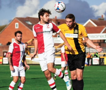 JOHNNY ON THE SPOT – John Goddard rises highest to win a header; Woking were head and shoulders above sorry Southport all day