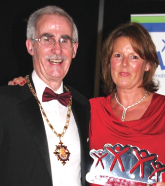 A LADY IN RED – Woking Mayor, Tony Branagan, with Fiona Hope, who is a LinkAbility supporter