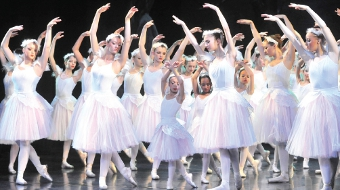 ALL WHITE ON THE NIGHT – Woking's ballerinas (right) triumphed with the principal dancers