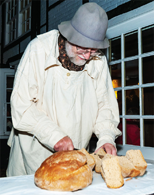 A CUT ABOVE - Peter Skinner tests the bread for abnormalities