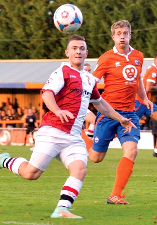 EYES ON THE BALL – Woking's Jack Marriott had one clear sight of a (Pictures by: David Holmes)
