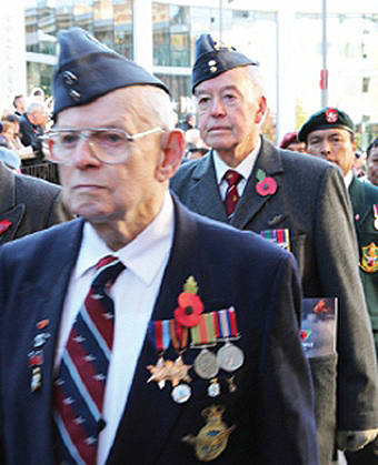 REFLECTING PERIOD – young and old stood side by side paying their respects