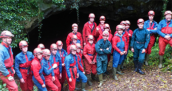 RED-DY TO ROCK 'N' ROLL – Explorer Scouts don their protective equipment for a bit of caving