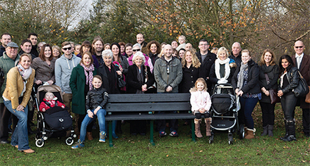 SIT DOWN NEXT TO ME – family and friends of the late Pete Oldfield and Kris Cook at the official unveiling of the memorial bench