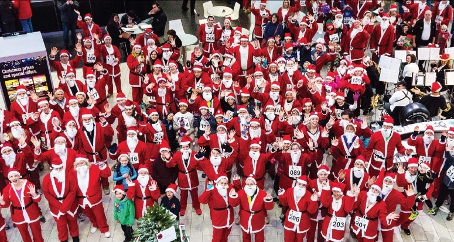 SEASON OF GOOD CHEER - hundreds of Santas gathered on Sunday for Woking & Sam Beare Hospices (Pictures by: Bob Holmes)