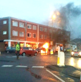 OLD WOKING FLAME – a passerby captures the exact moment the vehicle caught alight in Kingfield Road