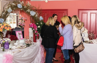 LOVE IS IN THE AIR – women gather around to find out what the fair at Brooklands has to offer