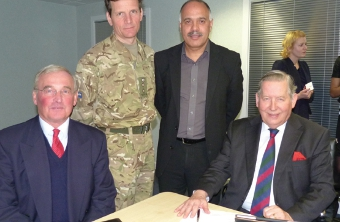 HARD AT WORK – Brigadier Paul Evans from BAE Systems, Colonel Charlie Lambert Garrison Commander Aldershot, Arcom IT CEO Shahid Azeem and Leader of Woking Borough Cllr John Kingsbury