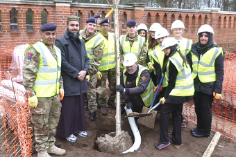 THE FINAL TOUCHES – the last silver birch arrives at the Peace Garden