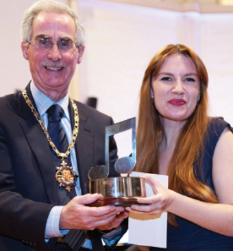 Melody maker – the Mayor of Woking, Tony Branagan, presents Flora MacDonald with the coveted Most Promising Singer accolade