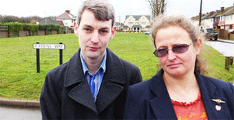 COULD BE A SITE FOR SORE EYES – Lib Dem Cllrs Will Forster and Louise Morales in front of the remaining open land on Rydens Way