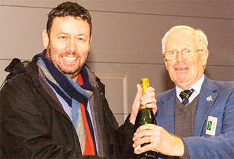 FIRST IN CLASS – Director Allan Winn presents the prize for best trial run to Marcus Atkin