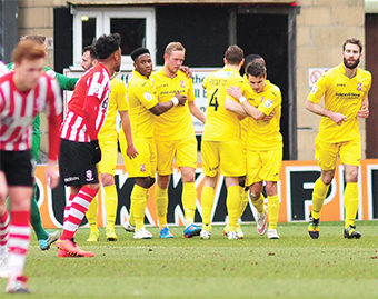 THE SCORING DOESN'T REND THERE – assured scorer Scott Rendell (centre) is congratulated by his Woking team-mates after his early opener