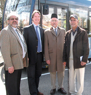 THE KEEPER OF THE PEACE – longstanding supporter of harmony and diversity Hameed Ahmad (right) with associates from his organisation and Jonathan Lord MP at the launch of the Woking AMC peace bus in 2012