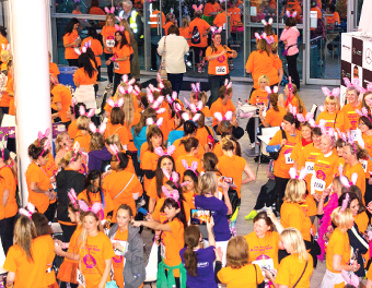 OCEAN OF ORANGE – a bird's eye view of participants preparing for the Midnight Walk
