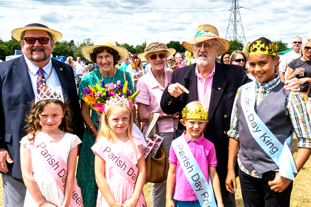 ROYAL WELCOME – Woking Mayor and Mayoress with special guests Bernard and Gillian Cribbins and Byfleet Parish Day's Royal Family: Queen Leila Watson, Princess Brooke Madden, Prince Lennon Collins and King Dylan Ungariage along with the Mayor and Mayoress of Woking, Derek and Rosemary McCrum