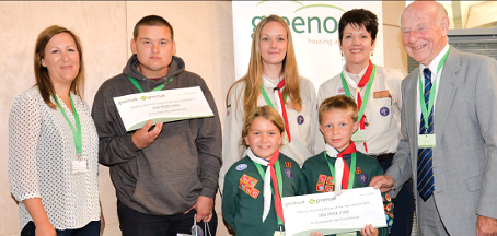 WELL DESERVED – Volunteer Team of the Year runners-up: 1st Goldsworth Park Scouts, SPED's Luke Clark and Greenoak's Ian Phillips (far right)