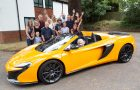 Margaret's family helping her to celebrate her 100th birthday while she is sitting in style in this McLaren 650 Spyder.