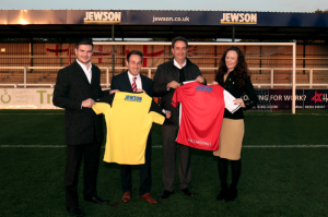 FULL BACKING – pictured (from left to right): Elliott Thomas, marketing executive, Jewson; Elliot Machin, commercial manager, Woking FC; Neil Obsorne, area director, Jewson; Clare Harding, marketing manager, Jewson Picture: wokingfc.co.uk
