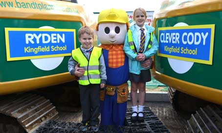 Bob the Builder with competition winners Louie and Beth