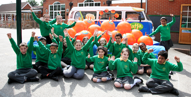 CHECK US OUT – pupils at Brookwood Primary school celebrate their prize